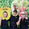 Burlington Chopped Leaf opening having fun at lettuceparty photo booth with vegetable cutouts